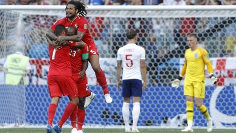 Panama's Blas Perez jumps over teammate Felipe Baloy after he scored his side's opening goal against England during a group G match at the 2018 soccer World Cup at the Nizhny Novgorod Stadium in Nizhny Novgorod , Russia, Sunday, June 24, 2018. (AP Photo/Victor Caivano)
