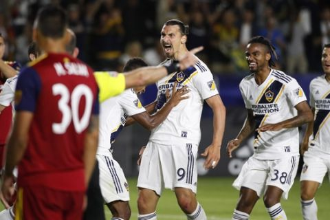 LA Galaxy's Zlatan Ibrahimovic, center, of Sweden, celebrates his goal with teammates during the second half of an MLS soccer match against the Real Salt Lake Saturday, June 9, 2018, in Carson, Calif. The Galaxy won 3-0. (AP Photo/Jae C. Hong)
