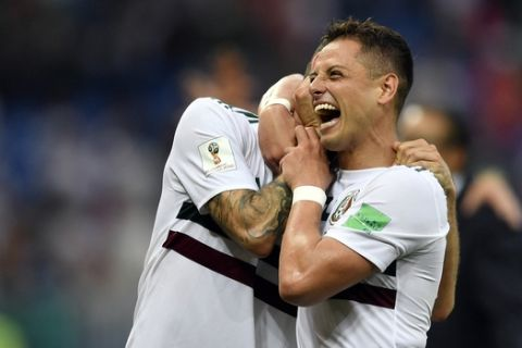 Mexico's Javier Hernandez, right, and Miguel Layun celebrate at the end of the group F match between Mexico and South Korea at the 2018 soccer World Cup in the Rostov Arena in Rostov-on-Don, Russia, Saturday, June 23, 2018. (AP Photo/Martin Meissner)
