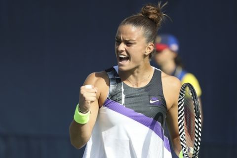 Maria Sakkari, of Greece, reacts after a shot to Camila Giorgi, of Italy, during the first round of the US Open tennis tournament Monday, Aug. 26, 2019, in New York. (AP Photo/Michael Owens)