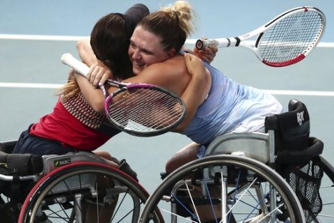 Japan's Yui Kamiji, left, and Britain's Jordanne Whiley, right, celebrate after defeating Dieke De Groot and Aniek Van Koot of the Netherlands in the women's wheelchair doubles final at the Australian Open tennis championship in Melbourne, Australia, Friday, Jan. 31, 2020. (AP Photo/Dita Alangkara)