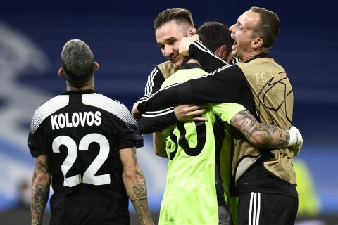 Sheriff's players celebrate at the end of the Champions League group D soccer match between Real Madrid and Sheriff, Tiraspol at the Bernabeu stadium in Madrid, Spain, Tuesday, Sept. 28, 2021. (AP Photo/Jose Breton)