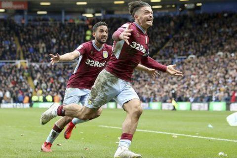Aston Villa's Jack Grealish, right, celebrates scoring against Birmingham City during the Sky Bet Championship soccer match at St Andrew's Trillion Trophy Stadium, Birmingham, England, Sunday March 10, 2019. (Nick Potts/PA via AP)