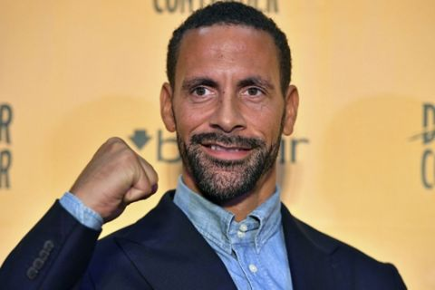 Ex-footballer Rio Ferdinand poses for the media during a press conference at York Hall, London, Tuesday, Sept. 19, 2017. Former England and Manchester United defender Rio Ferdinand is looking to become a professional boxer. The 38-year-old Ferdinand will be trained by former WBC super-middleweight champion Richie Woodhall, who has worked with Britain's Olympic team. The retired soccer player's move into boxing is linked to a betting company renowned for stunts. (Dominic Lipinski/PA via AP)