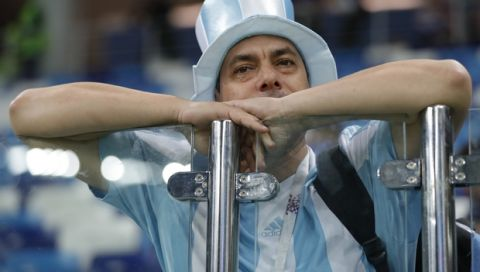 An Argentinian fan leans on a security glass at the end of the group D match between Argentina and Croatia at the 2018 soccer World Cup in Nizhny Novgorod Stadium in Nizhny Novgorod, Russia, Thursday, June 21, 2018. Croatia defeated Argentina 3-0. (AP Photo/Ricardo Mazalan)