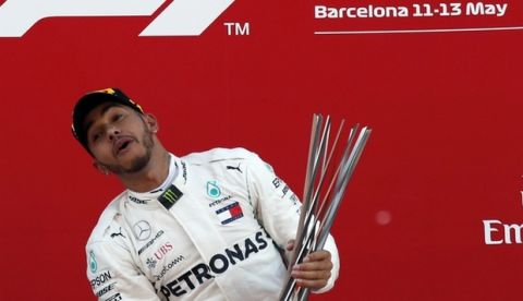 Mercedes driver Lewis Hamilton of Britain celebrates on the podium after winning the Spanish Formula One Grand Prix at the Barcelona Catalunya racetrack in Montmelo, Spain, Sunday, May 13, 2018. (AP Photo/Manu Fernandez)