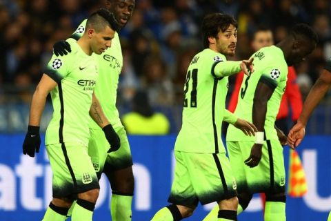 KIEV, UKRAINE - FEBRUARY 24:  Sergio Aguero of Manchester City is congratulated by teammate Yaya Toure after scoring the opening goal during the UEFA Champions League round of 16, first leg match between FC Dynamo Kyiv and Manchester City FC at the Olympic Stadium on February 24, 2016 in Kiev, Ukraine.  (Photo by Michael Steele/Getty Images)