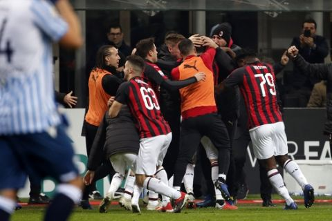 AC Milan players celebrate after scoring their second goal during a Serie A soccer match between AC Milan and Spal, at the San Siro stadium, Saturday, Dec. 29, 2018. (AP Photo/Antonio Calanni)