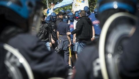 Policemen face SS Lazio supporters outside Olimpico Stadium before the kick off of Italian Serie A soccer match between As Roma and Ss Lazio,  Roma 25 May 2015. Two soccer fans were stabbed near the Olympic stadium before the highly anticipated Roma-Lazio derby, police said Monday. The pair, each stabbed in the abdomen, were rushed by ambulance to hospital as code red emergencies.ANSA/ANGELO CARCONI
