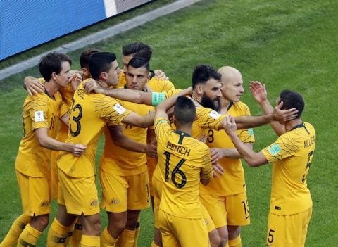 Australia's Mile Jedinak celebrates witht teammates after scoring his side's opening goal during the group C match between France and Australia at the 2018 soccer World Cup in the Kazan Arena in Kazan, Russia, Saturday, June 16, 2018. (AP Photo/Hassan Ammar)