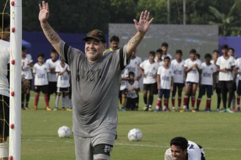 Diego Maradona, gestures as he attends a football clinic and workshop for young aspiring soccer players in Kadambagachhi, about 45 kilometers (28 miles) north of Kolkata, India, Tuesday, Dec. 12, 2017. The 1986 World Cup-winning captain for Argentina is on a three day visit to Kolkata. (AP Photo/Bikas Das)
