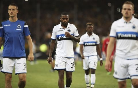 Club Brugge players walk off the field after being defeated by AEK Athens at the end of an UEFA Europa league play-off second leg soccer match between Club Brugge and AEK at the Olympic stadium in Athens, on Thursday, Aug. 24, 2017. AEK won 3-0.(AP Photo/Petros Giannakouris)