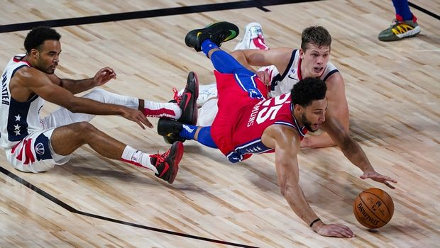 Philadelphia 76ers guard Ben Simmons (25) goes for a loose ball with Washington Wizards guard Jerome Robinson, left, and forward Moritz Wagner, right. during the first half of an NBA basketball game Wednesday, Aug. 5, 2020 in Lake Buena Vista, Fla. (AP Photo/Ashley Landis)
