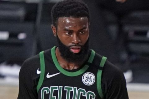 Miami Heat's Jae Crowder (99) argues a call during the second half of an NBA conference final playoff basketball game against the Boston Celtics Friday, Sept. 25, 2020, in Lake Buena Vista, Fla. At left is Celtics' Jaylen Brown (7). (AP Photo/Mark J. Terrill)