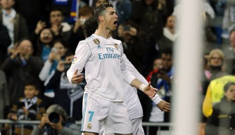 Real Madrid's Cristiano Ronaldo celebrates after scoring during a Spanish La Liga soccer match between Real Madrid and Girona at the Santiago Bernabeu stadium in Madrid, Spain, Sunday, March 18, 2018. (AP Photo/Paul White)