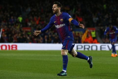 FC Barcelona's Lionel Messi celebrates after scoring during the Spanish La Liga soccer match between FC Barcelona and Leganes at the Camp Nou stadium in Barcelona, Spain, Saturday, April 7, 2018. (AP Photo/Manu Fernandez)