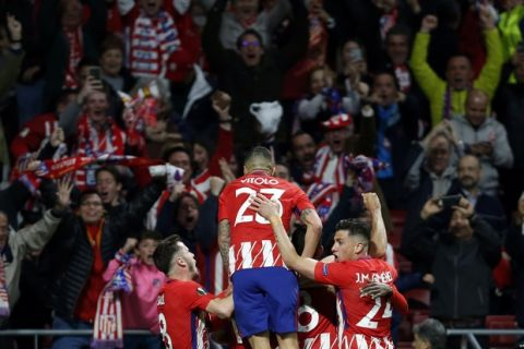 Atletico's Diego Costa celebrates with teammates after scoring his side's opening goal during the Europa League semifinal, second leg soccer match between Atletico Madrid and Arsenal at the Metropolitano stadium in Madrid, Spain, Thursday, May 3, 2018. (AP Photo/Francisco Seco)