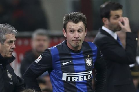 Inter Milan forward Antonio Cassano is assisted by a team doctor during a Serie A soccer match between Inter Milan and Atalanta, at the San Siro stadium in Milan, Italy, Sunday, April 7, 2013. (AP Photo/Luca Bruno)
