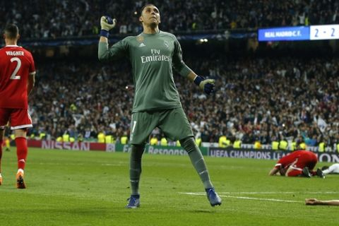 Real Madrid's goalkeeper Keylor Navas, center, celebrates after Madrid reached its third straight Champions League final 4-3 on aggregate at the Champions League semifinal second leg soccer match between Real Madrid and FC Bayern Munich at the Santiago Bernabeu stadium in Madrid, Spain, Tuesday, May 1, 2018. (AP Photo/Paul White)