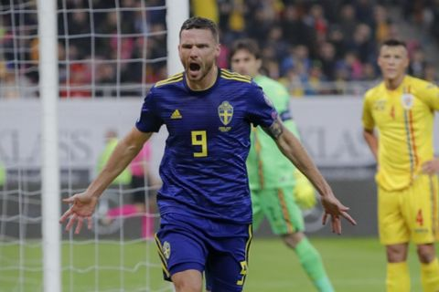 Sweden's Marcus Berg celebrates after scoring his side's first goal during the Euro 2020 group F qualifying soccer match between Romania and Sweden on the National Arena stadium in Bucharest, Romania, Friday, Nov. 15, 2019. (AP Photo/Vadim Ghirda)