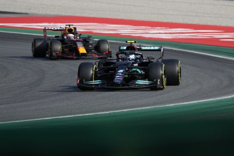 Mercedes driver Valtteri Bottas of Finland leads Red Bull driver Max Verstappen of the Netherlands at the start of the Sprint Race qualifying session at the Monza racetrack, in Monza, Italy , Saturday, Sept.11, 2021. The Formula one race will be held on Sunday. (AP Photo/Luca Bruno)
