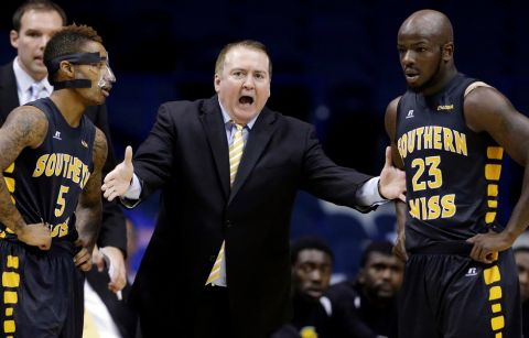 FILE - In this Nov. 13, 2013 file photo, then-Southern Mississippi head coach Donnie Tyndall, center, talks to guards Neil Watson, left, and Jerrold Brooks during the first half of an NCAA college basketball game against DePaul, in Rosemont, Ill. An attorney for former Southern Mississippi basketball coach Donnie Tyndall says the coach's NCAA infractions case appeal hearing will be on Thursday, Sept. 8, 2016,  in Indianapolis. (AP Photo/Nam Y. Huh, File)