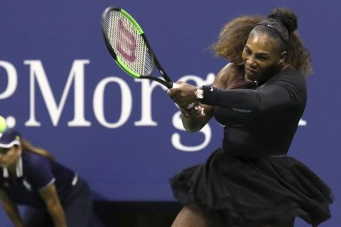 Serena Williams returns a shot to Venus Williams in the third round of the U.S. Open tennis tournament at the USTA Billie Jean King National Tennis Center on Friday, Aug. 31, 2018, in New York. (Photo by Greg Allen/Invision/AP)