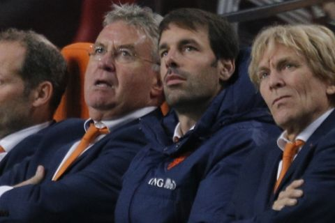 Netherlands head coach Guus Hiddink, second left, and assistant coach Ruud van Nistelrooy, second right, watch a replay of the sixth goal during the Euro 2016 group A qualifying round soccer match between the Netherlands and Latvia at ArenA stadium in Amsterdam, Netherlands, Sunday, Nov. 16, 2014. Netherlands won the match with a 6-0 score. (AP Photo/Peter Dejong)