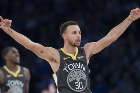 Golden State Warriors guard Stephen Curry gestures during final minutes of the second half of an NBA basketball game against the New York Knicks, Friday, Oct. 26, 2018, at Madison Square Garden in New York. The Warriors won 128-100. (AP Photo/Mary Altaffer)