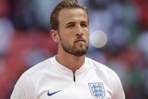 England captain Harry Kane stands for the anthems before the international friendly soccer match between England and Nigeria at Wembley stadium in London, Saturday, June 2, 2018. (AP Photo/Matt Dunham)