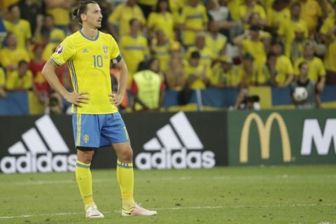 Sweden's Zlatan Ibrahimovic stands dejected  during the Euro 2016 Group E soccer match between Sweden and Belgium at the Allianz Riviera stadium in Nice, France, Wednesday, June 22, 2016. (AP Photo/Ariel Schalit)