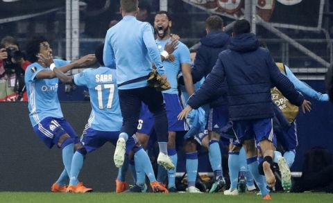Marseille's Rolando, center, is celebrated after scoring his side's first goal in the additional time during the Europa League semifinal second leg soccer match between FC Salzburg and Olympique Marseille in Salzburg, Austria, Thursday, May 3, 2018. (AP Photo/Matthias Schrader)
