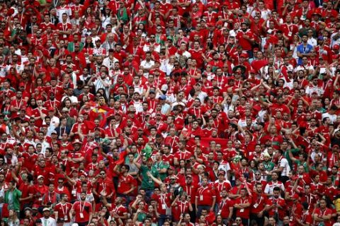 Fans watch the group B match between Portugal and Morocco at the 2018 soccer World Cup in the Luzhniki Stadium in Moscow, Russia, Wednesday, June 20, 2018. (AP Photo/Francisco Seco)