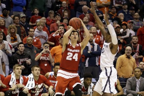Wisconsin's Bronson Koenig (24) shoots a last second 3-point shot over Xavier's Remy Abell to give Wisconsin a 66-63 victory in a second-round men's college basketball game in the NCAA Tournament, Sunday, March 20, 2016, in St. Louis. (AP Photo/Jeff Roberson)