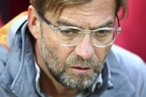 Liverpool coach Jurgen Klopp sits on the bench during the Champions League semifinal, first leg, soccer match between Liverpool and AS Roma at Anfield Stadium, Liverpool, England, Tuesday, April 24, 2018. (AP Photo/Dave Thompson)