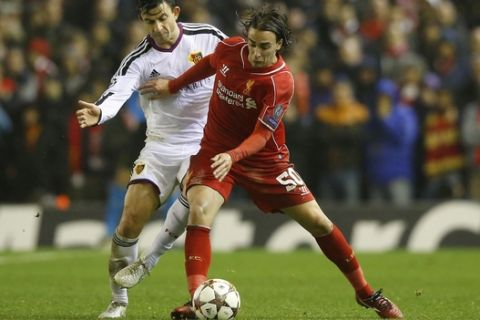 Liverpool's Lazar Markovic, right, fights for the ball against Basel's Behrang Safari in the incident which led to the former being shown a red a card by referee Bjorn Kuipers during the Champions League Group B soccer match between Liverpool and FC Basel at Anfield Stadium in Liverpool, England, Tuesday, Dec. 9, 2014. (AP Photo/Jon Super)