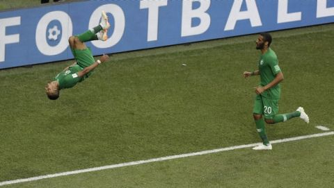Saudi Arabia's Salem Aldawsari flips to celebrate scoring his side's winning goal during the group A match against Egypt at the 2018 soccer World Cup at the Volgograd Arena in Volgograd, Russia, Monday, June 25, 2018. Saudi Arabia won 2-1. (AP Photo/Themba Hadebe)