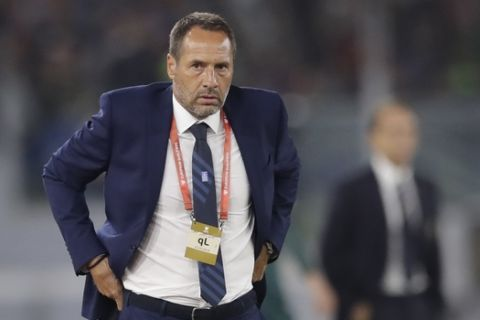 Greece's John van't Schip watches his team play from the sidelines during the Euro 2020 group J qualifying soccer match between Italy and Greece in Rome, Italy, Saturday, Oct. 12, 2019. (AP Photo/Alessandra Tarantino)