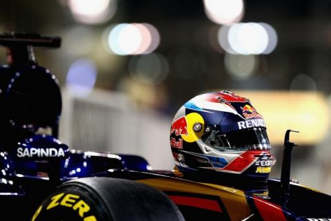 ABU DHABI, UNITED ARAB EMIRATES - NOVEMBER 26:  Max Verstappen of Netherlands and Scuderia Toro Rosso's helmet rests on the front of his car as the team prepares for a photograph in the pit labe during previews for the Abu Dhabi Formula One Grand Prix at Yas Marina Circuit on November 26, 2015 in Abu Dhabi, United Arab Emirates.  (Photo by Clive Mason/Getty Images)