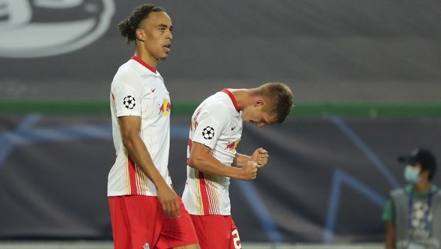 Leipzig's Dani Olmo, right, celebrates after scoring his side's first goal during the Champions League quarterfinal match between RB Leipzig and Atletico Madrid at the Jose Alvalade stadium in Lisbon, Portugal, Thursday, Aug. 13, 2020. (Miguel A. Lopes/Pool Photo via AP)