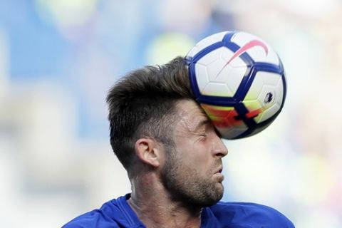 Chelsea's Gary Cahill heads the ball during the English Premier League soccer match between Chelsea and Liverpool at Stamford Bridge stadium in London, Sunday, May 6, 2018. (AP Photo/Kirsty Wigglesworth)