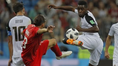 Costa Rica's Joel Campbell, right, vies for the ball with Switzerland's Ricardo Rodriguez during the group E match between Switzerland and Costa Rica at the 2018 soccer World Cup in the Nizhny Novgorod Stadium in Nizhny Novgorod , Russia, Wednesday, June 27, 2018. (AP Photo/Vadim Ghirda)