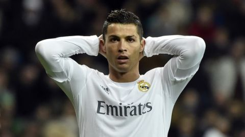 Real Madrid's Portuguese forward Cristiano Ronaldo reacts to missing a goal opportunity during the UEFA Champions League round of 16, second leg football match Real Madrid FC vs AS Roma at the Santiago Bernabeu stadium in Madrid on March 8, 2016. / AFP / GERARD JULIEN        (Photo credit should read GERARD JULIEN/AFP/Getty Images)