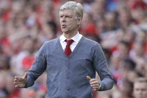 Arsenal's French manager Arsene Wenger reacts to a missed chance by his team during the English Premier League soccer match between Arsenal and Burnley at the Emirates Stadium in London, Sunday, May 6, 2018. The match is Arsenal manager Arsene Wenger's last home game in charge after announcing in April he will stand down as Arsenal coach at the end of the season after nearly 22 years at the helm. (AP Photo/Matt Dunham)