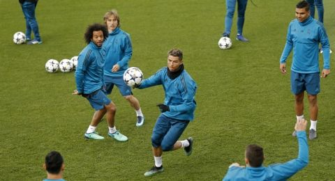 Real Madrid's Cristiano Ronaldo, centre, plays the ball with teammates during a training session at the team's Valdebebas training ground in Madrid, Monday, April 30, 2018. Real Madrid will play a Champions League semi final second leg soccer match with Bayern Munich on Tuesday, May 1. (AP Photo/Francisco Seco)