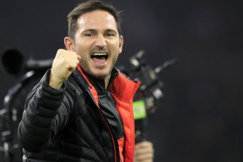 Chelsea's head coach Frank Lampard celebrates at the end of the group H Champions League soccer match between Ajax and Chelsea at the Johan Cruyff ArenA in Amsterdam, Netherlands, Wednesday, Oct. 23, 2019. Chelsea won 1:0. (AP Photo/Peter Dejong)