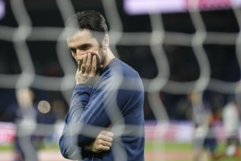 PSG's goalkeeper Gianluigi Buffon appears to be in a pensive mood prior to the French League One soccer match between Paris-Saint-Germain and Olympique Marseille at the Parc des Princes stadium in Paris, Sunday, March 17, 2019. (AP Photo/Christophe Ena)