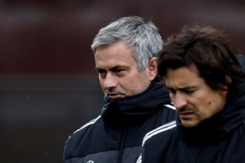 Chelsea manager Jose Mourinho, left, and assistant first team coach Rui Faria, arrive for the team's training session at Cobham training ground, in Cobham, England, Tuesday, Nov. 5, 2013 ahead of their Champions League group soccer match against Schalke on Wednesday. (AP Photo/Lefteris Pitarakis)
