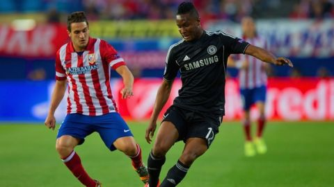 MADRID, SPAIN - APRIL 22:  John Obi Mikel of Chelsea and Koke of Club Atletico de Madrid compete for the ball during the UEFA Champions League Semi Final first leg match between Club Atletico de Madrid and Chelsea at Vicente Calderon Stadium on April 22, 2014 in Madrid, Spain.  (Photo by Gonzalo Arroyo Moreno/Getty Images)