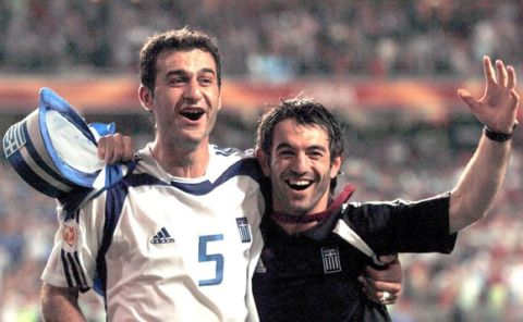 Traianos Dellas, left, and Georgios Karagounis of Greece celebrate their 1-0 victory over Portugal in the Euro 2004 soccer championship final at the Luz stadium in Lisbon, Portugal, Sunday, July 4, 2004. (AP Photo/Dusan Vranic) **  FOR EDITORIAL USE ONLY NO WIRELESS COMMERCIAL OR PROMOTIONAL LICENSING PERMITTED  **